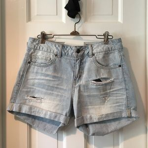 Low rise distressed and ripped denim shorts